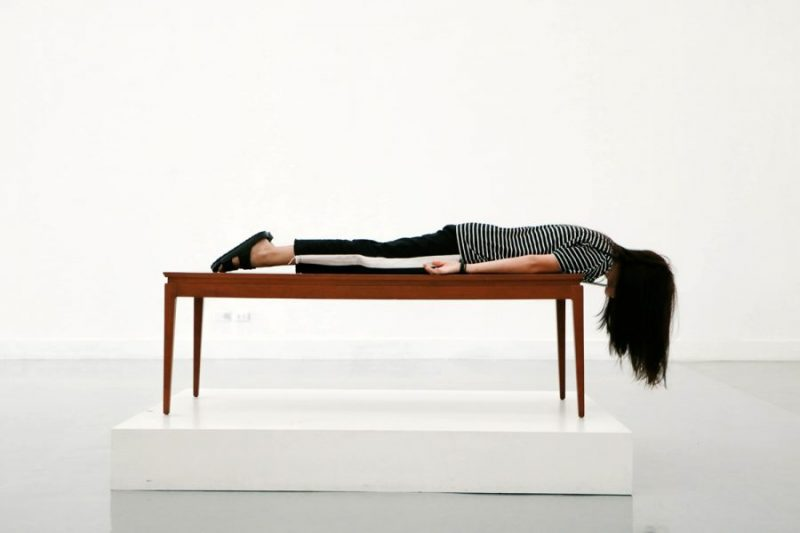 Woman lying prone on table.